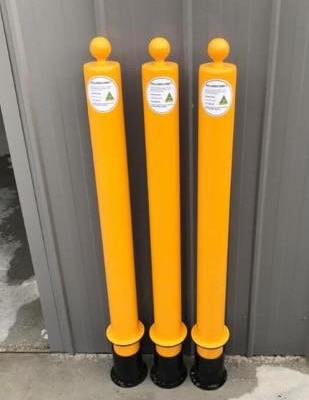 three pieces of yellow bollards by Bollards Direct